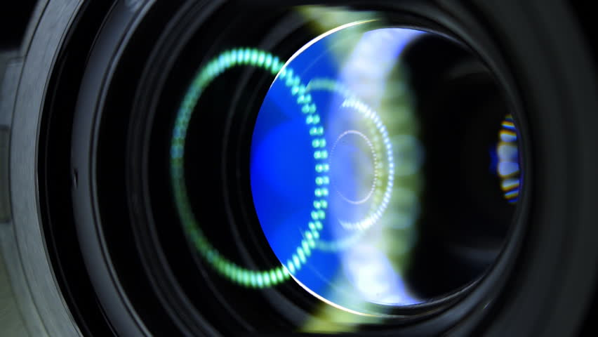 Camera lens flare closeup with laminated reflection