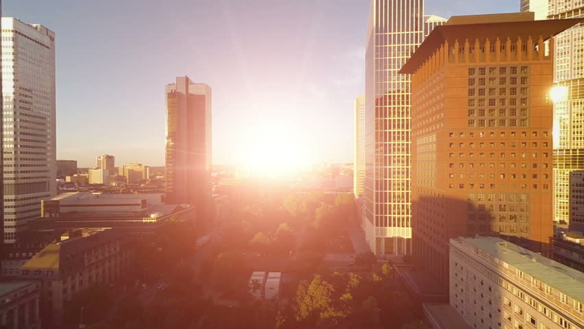 Aerial view of city skyline at sunset. frankfurt business banking district. skyscrapers towers buildings. fly over. helicopter view | Shutterstock HD Video #6694661