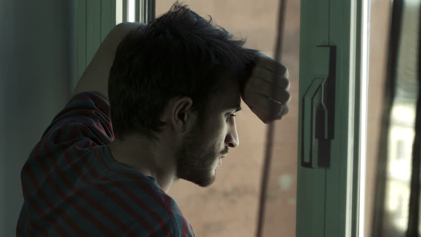 Portrait of handsome young sad man in front of a window, 4k #6704321