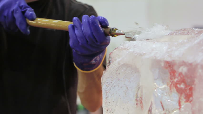 "ROME - MARCH 7 2014 ""Ice Carver Using Chisel to Carve ar Motor Day 2014"", Rome, Italy 