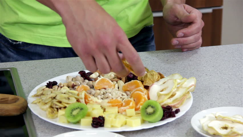 Healthy dish with cheese and dried fruit preparing dish with adding honey to healthy dish with seeds preparing dish with healthy diet food from seeds forumfinder Image collections