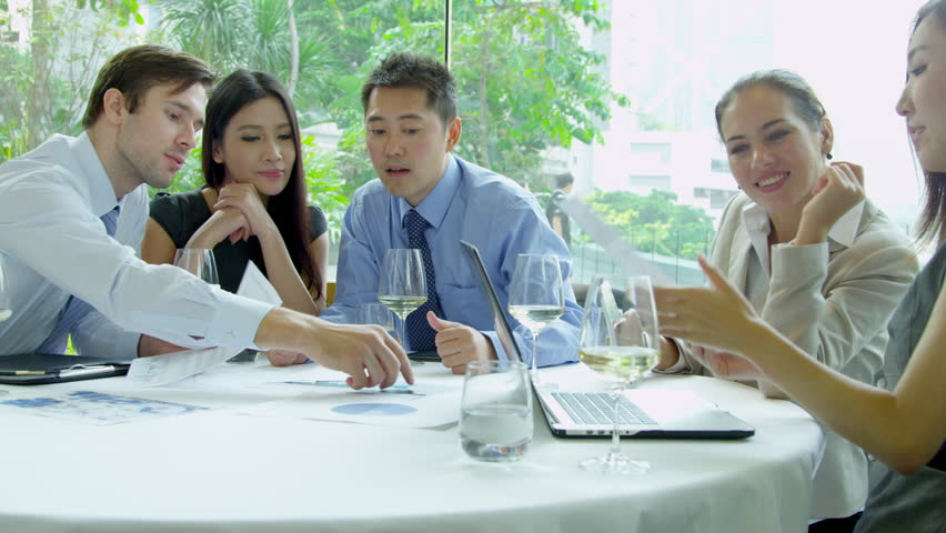 Caucasian Asian Chinese group financial investors collaborating future business plans using spreadsheets lunch meeting close up shot on RED EPIC | Shutterstock HD Video #6724441