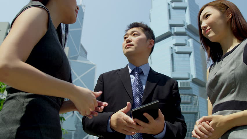 Close up young ethnic business team using wireless tablet hot spot outdoors modern downtown city environment shot on RED EPIC | Shutterstock HD Video #6724951