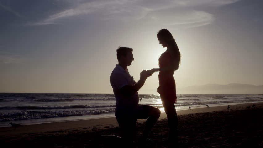 Man Proposing To Woman Sunset Lit Beach Stock Footage Video 12239750