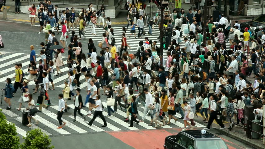 TOKYO - June 16, Pedestrian crossing in the Shibuya district of Tokyo, 16 June, 2014 in Tokyo, Japan #6766231