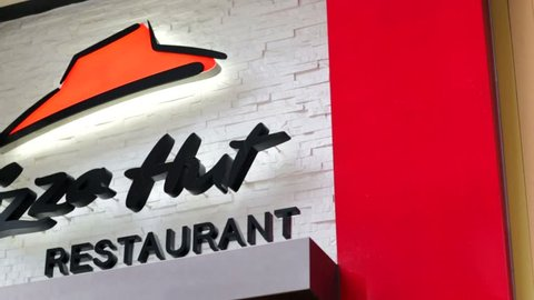 HONG KONG, CHINA - CIRCA JUNE 2014: Pizza Hut Restaurant Sign. Pizza Hut is an American restaurant chain and international franchise that offers different styles of pizza.