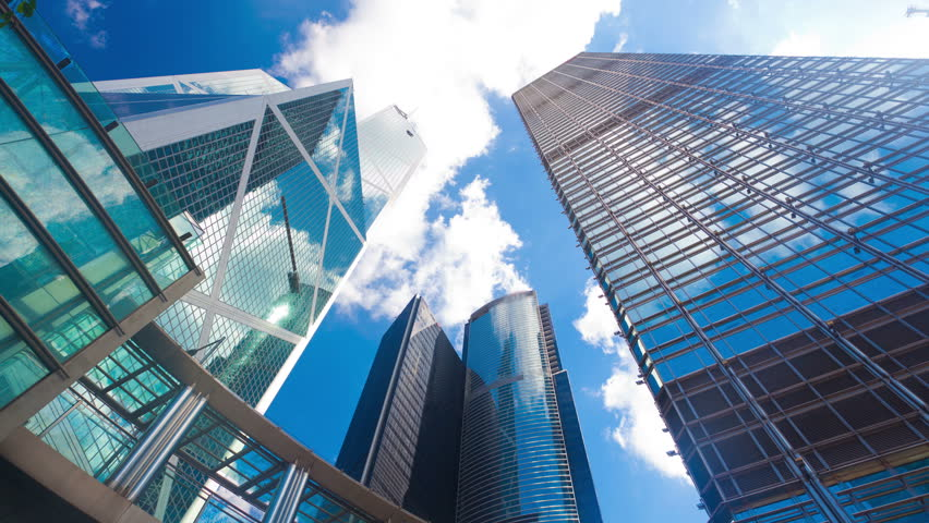 4k timelapse video of office buildings with reflection of clouds, zooming in #6789211