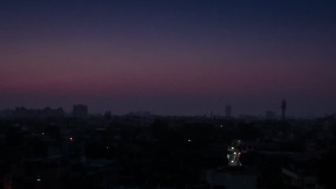 Calcutta timelapse sunrise. The sun rises over the urban sprawl of downtown Calcutta / Kolkata. There is beauty even in this dusty wasteland.