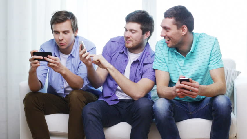 Friends Playing Video Games While Laughing In The Living Room