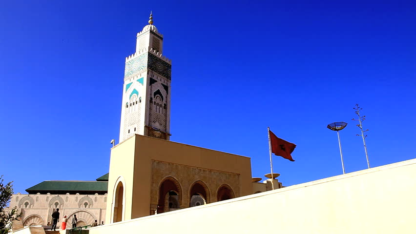 Great mosque of hassan II and moroccan flag in casablanca, morocco | Shutterstock HD Video #6803101