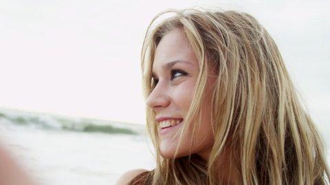 00bd919d56 Head shoulders young Caucasian female wearing bikini enjoying beach  vacation smiling to camera filming social media