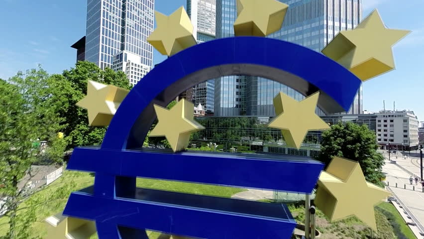 FRANKFURT, GERMANY – JUNE 06, 2014: Euro Sign in front of European Central Bank. (Euro currency symbol) for editorial use only