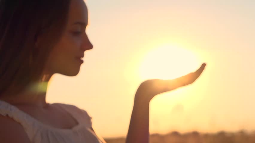 Sun in hands. Woman hand catching a sun against beautiful sunset on horizon. Nature. Vacation. Hope. Carpe diem. Opportunity concept. Freedom, hippie generation. Full HD 1080p