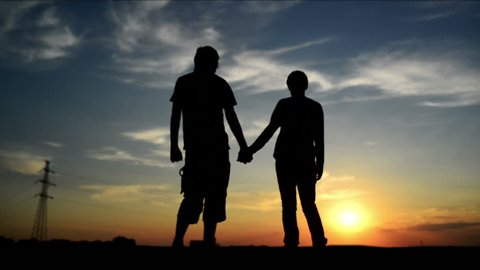 Lovers on a date in sunset, holding hands. Romantic love scene. 1920x 1080 full hd footage.