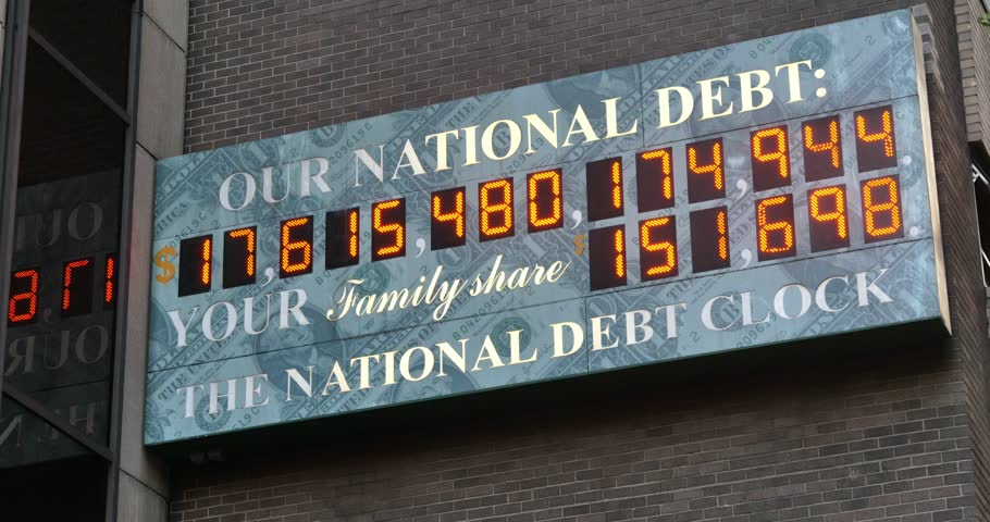 NEW YORK CITY - Circa July, 2014 - A summer establishing shot of the U.S. National Debt Clock counting up in Manhattan, New York.