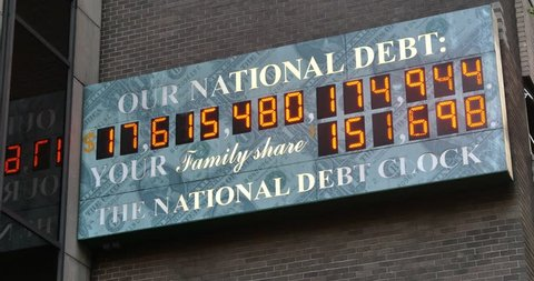 NEW YORK CITY - Circa July, 2014 - A summer establishing shot of the U.S. National Debt Clock counting up in Manhattan, New York.