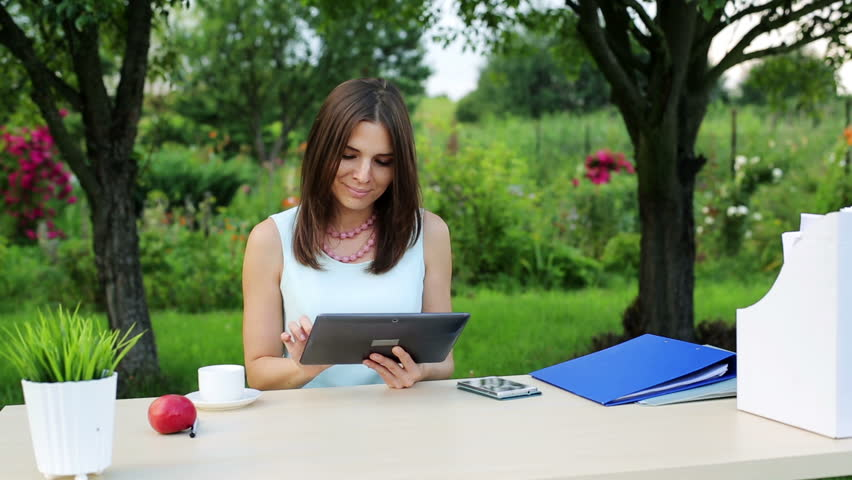 Happy Pretty Businesswoman With Tablet Computer By The Desk In Garden   HD  Stock Footage Clip