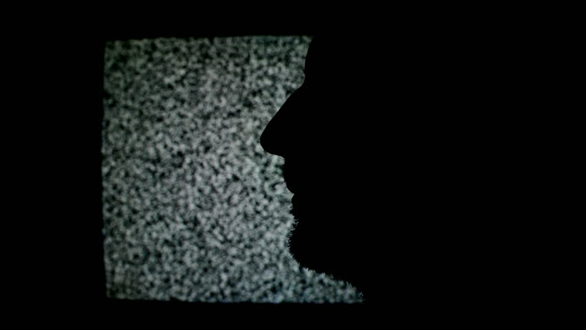 Man making Shhh sign with finger. Silhouette of unshaven male in front of static TV noise background. 1920x1080 full hd footage.