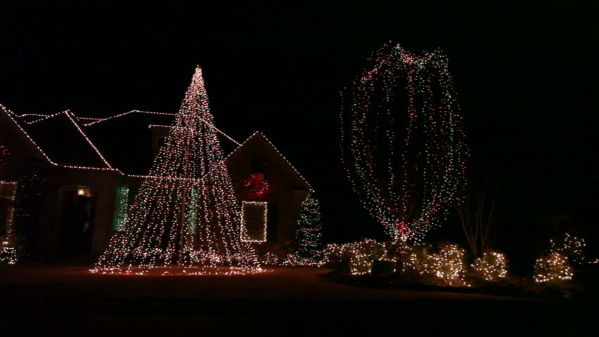 Dynamic illumination of the house exterior during Christmas in the dark