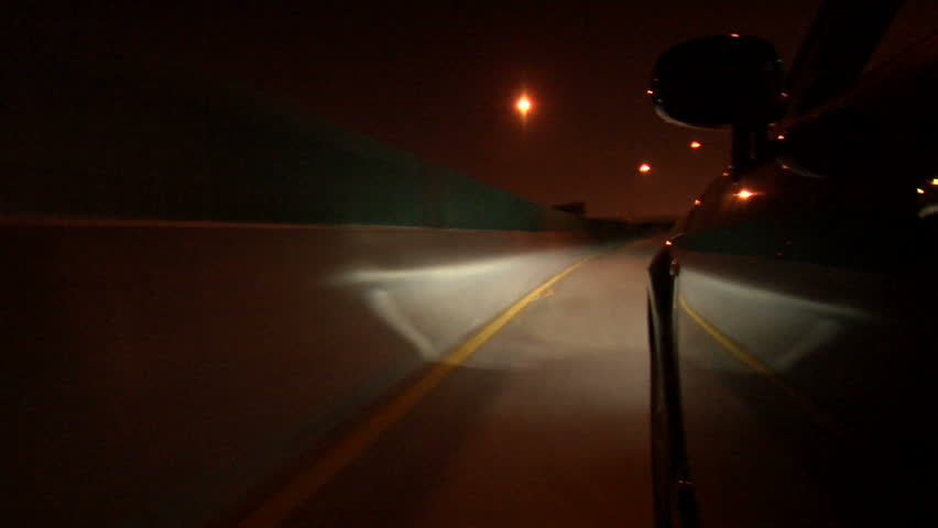 This is a car mount POV shot driving across a bridge, and exiting.  The footage