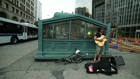 NEW YORK - JULY 22, 2014: street musician in Cooper Square, New York. Cooper Square, in Manhattan, is where 5 neighborhoods converge: Greenwich Village; NoHo; Lower East Side; Bowery; East Village.
