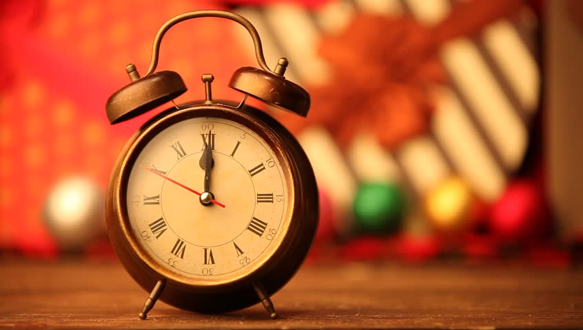 Retro alarm clock and christmas gifts on background