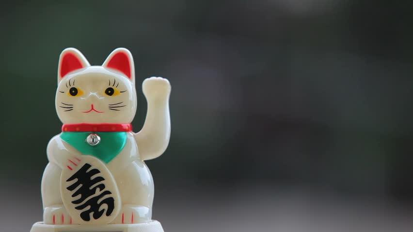 The maneki-neko, Beckoning cat - Japanese Lucky Charm