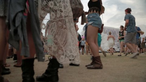 INDIO, CALIFORNIA - APRIL 18, 2014: timelapse of people in desert at Coachella in Indio, California. Coachella Valley Music Arts Festival is an annual music festival held at Empire Polo Club.
