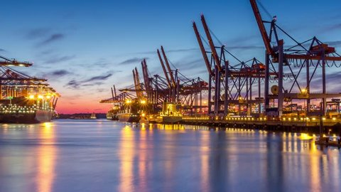 HAMBURG, GERMANY - JULY 22: Timelapse of Container Terminals in the port during Sunset. on July 22rd, 2014 in Hamburg