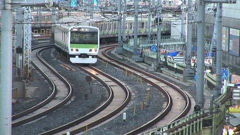 TOKYO, JAPAN - CIRCA 2010: Commuter train passes at Ueno Train Station in Tokyo