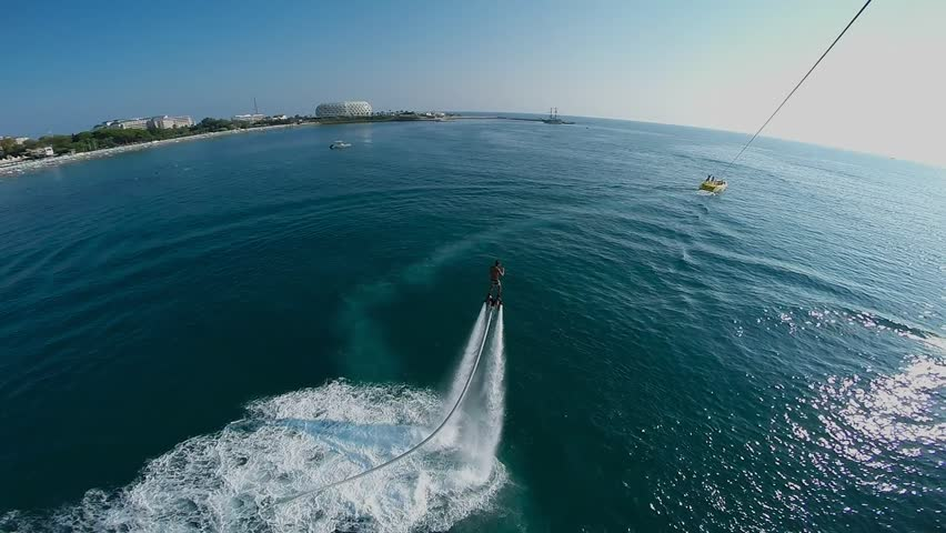 Man on flyboard, tourists flying on a parachute, parasailing, Alanya Turkey 2 | Shutterstock HD Video #6992311