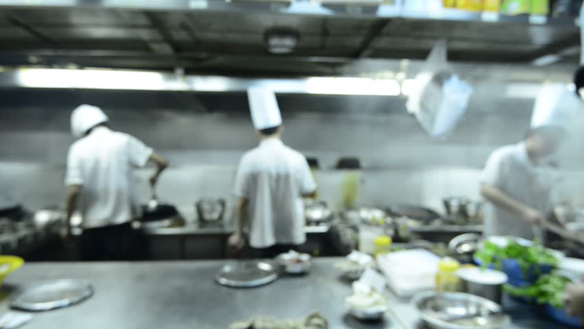 Restaurant Kitchen Video motion chefs of a restaurant kitchen stock footage video 7008409