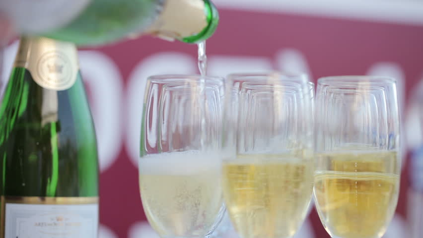 Champagne poured into glass cubs