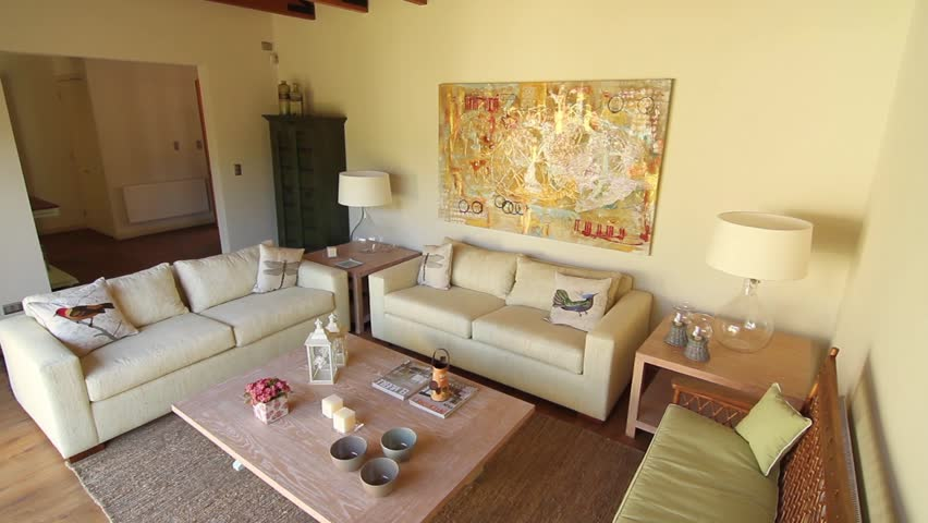 SANTIAGO, CHILE - Sunlight filters through an open window onto the cream  coloured couches in