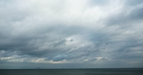 4k sparkling ocean sea water waves surface&coastal rock reef coast cloud cloudscape.dark clouds.altocumulus,high cumulus cloud,mackerel sky. gh2_08318_4k