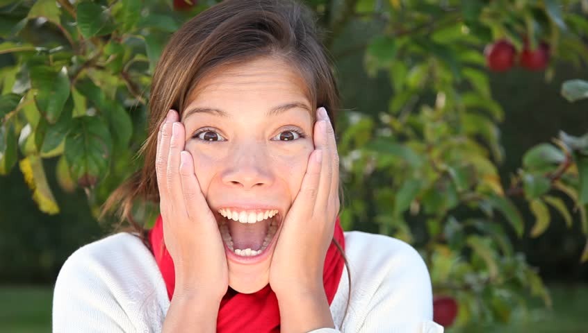 Surprised woman. Woman getting very surprised and excited outdoors in autumn.