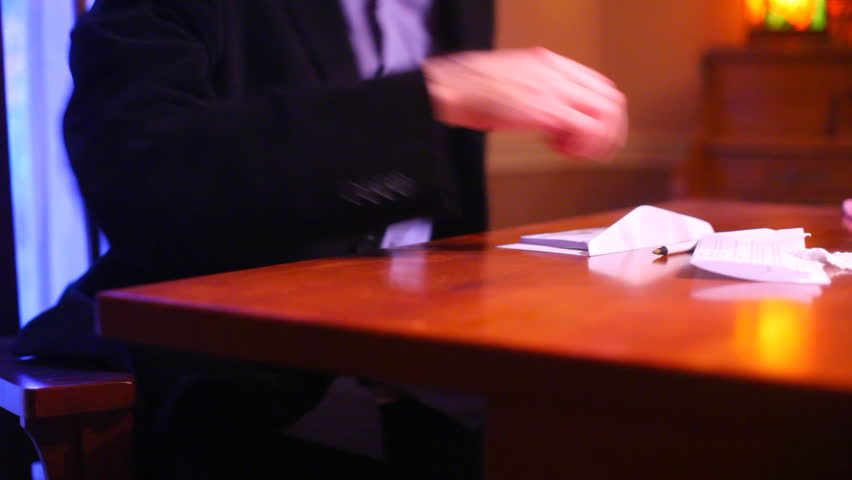 Writing a check or looking at paperwork  | Shutterstock HD Video #704791