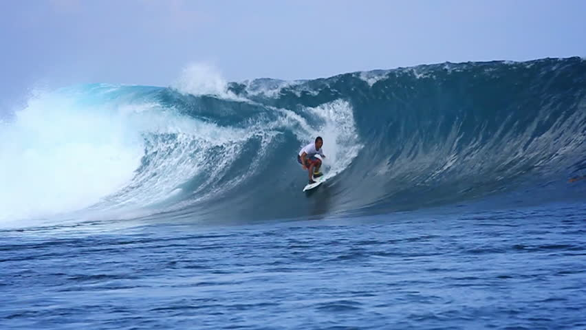 A surfer gets barreled on a powerful wave in slow motion | Shutterstock HD Video #7091791