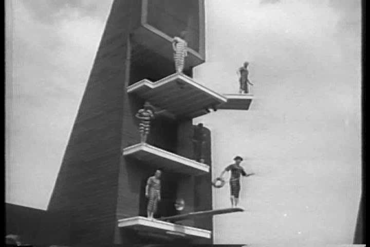 CIRCA 1950s - The Diving Maniacs put on a comedic diving show in Seattle in 1956. | Shutterstock HD Video #7098151