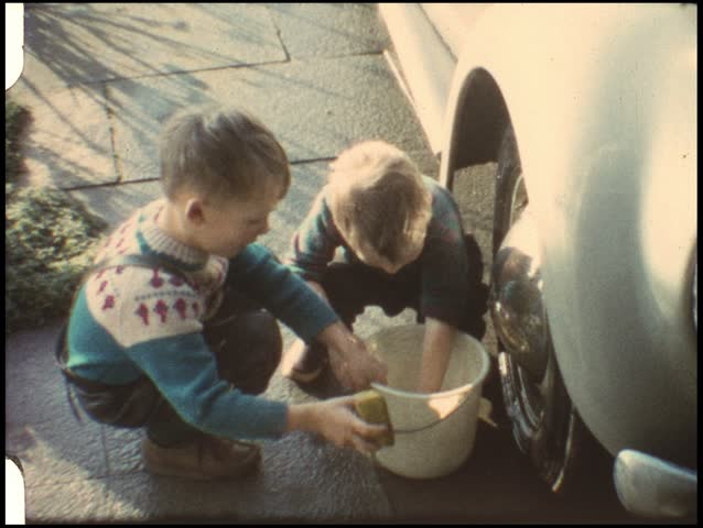 Boys washing fathers car (vintage 8 mm amateur film)