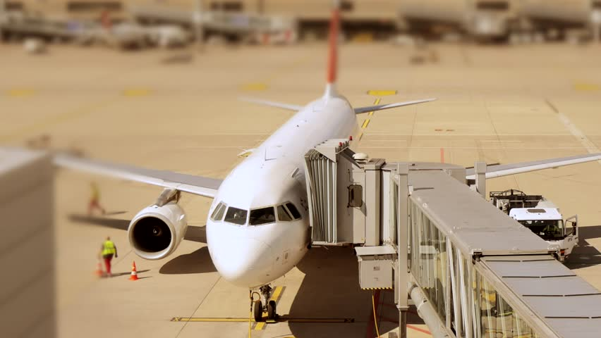Time lapse of airport - airplane aircraft plane - dock terminal gate - waiting - transportation - travel traveling - trip tour - commuter commuting background