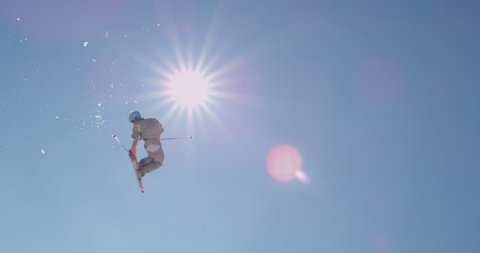 SLOW MOTION: Freestyle skier jumping a kicker