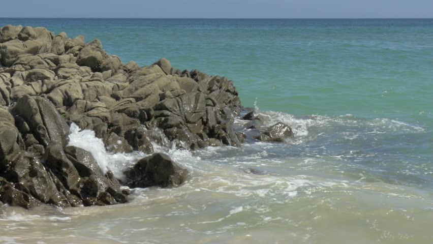Blue waves crashing at rocks along the clear summer Shimoda coast. | Shutterstock HD Video #7165231