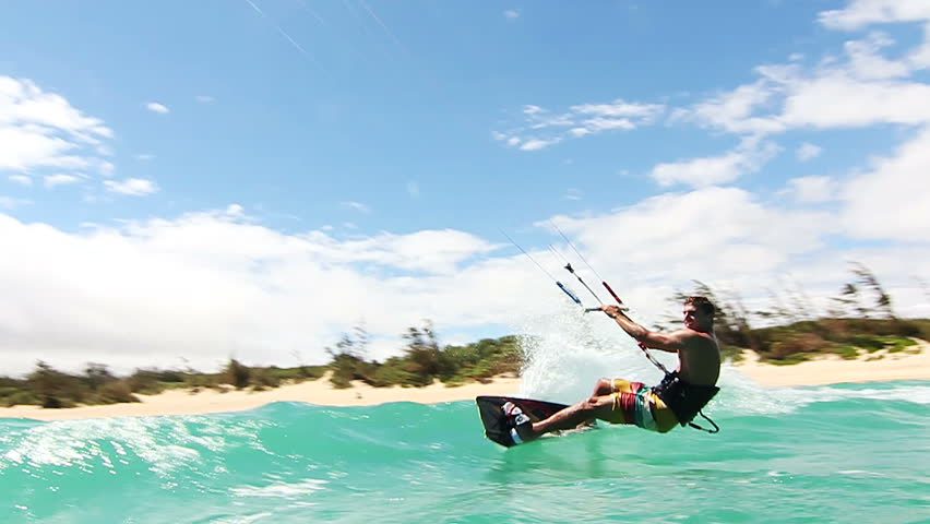 Young Man Kitesurfing In Ocean Doing Extreme Trick In Slow Motion