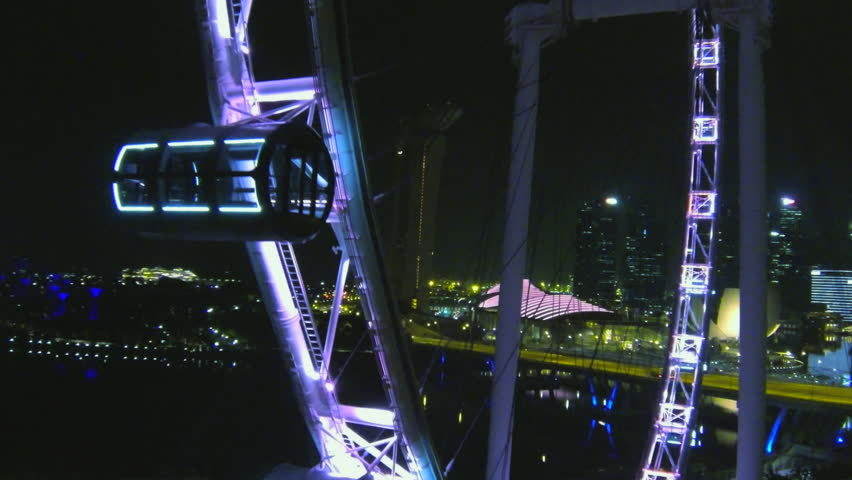 Aerial view of Singapore Flyer revealing Singapore city skyline at Marina Boulevard Aug 2014