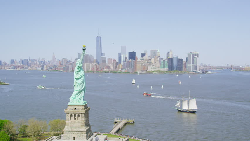 Helicopter aerial view of  Statue of Liberty, New York City State.  Flying overhead we see the iconic American Lady Statue. Famous United States tourism attraction.   Shutterstock HD Video #7198621