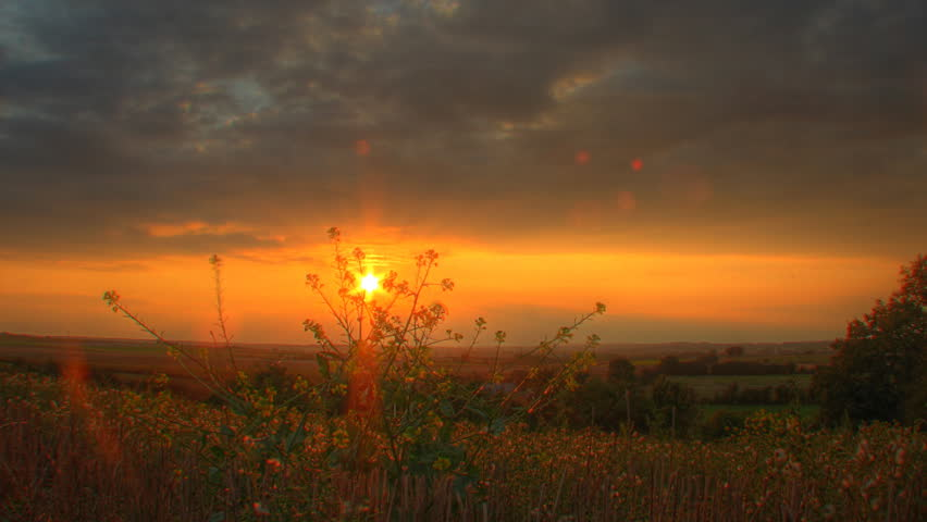 Warm sunset over fields, motorized time lapse clip, high dynamic range imaging (HDRI)