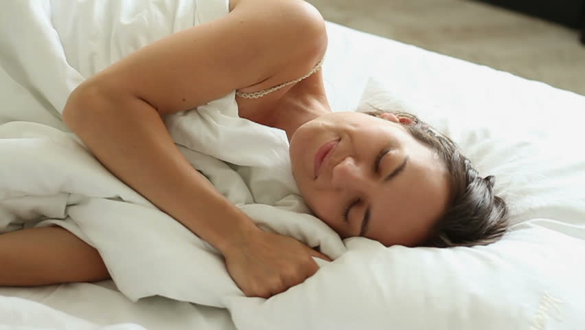 Young woman sleeping on the white linen in bed at home, slow motion | Shutterstock HD Video #7216741