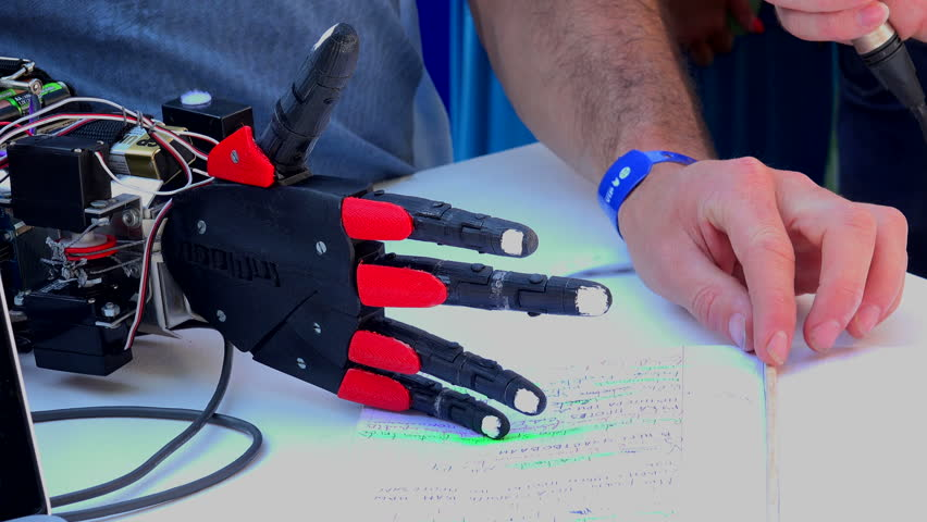 SAINT-PETERSBURG, RUSSIA - AUGUST 12, 2014: Electronic prosthetic arm. Shot in 4K (ultra-high definition (UHD)), so you can easily crop, rotate and zoom, without losing quality! Real time.