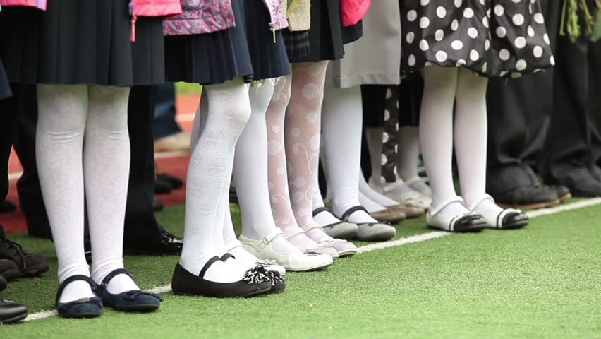 Feet Of Schoolgirls In White Pantyhose Kids Standing In
